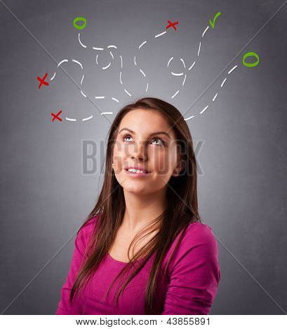 Beautiful young woman thinking with abstract marks overhead