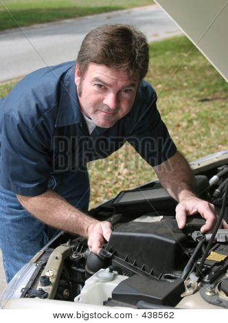 Handsome Mechanic Under Hood