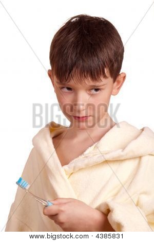 A Boy Brushing His Teeth After Bath