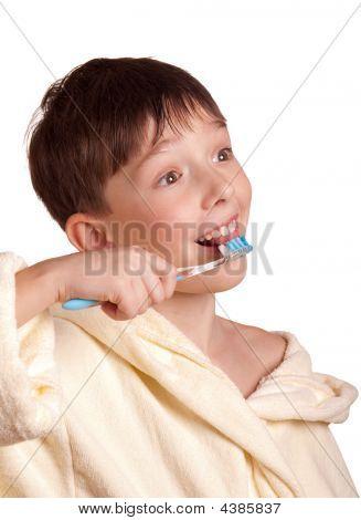 A Boy Brushing His Teeth After Bath