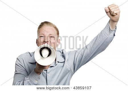Brilliant news: Young excited businessman with fist up shouting with megaphone isolated on white background.
