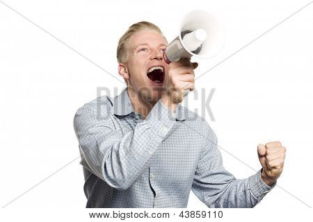 Fantastic news: Young happy businessman looking up while shouting with megaphone isolated on white background.