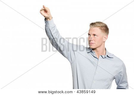 Portrait of young businessman drawing with finger in the air, blank space for text or symbol, isolated on white background.