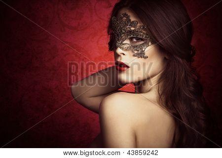 sensual beautiful young woman with lace mask, studio shot