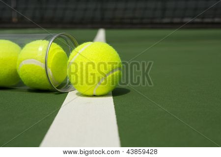 Tennis Balls from a Canister on the Court