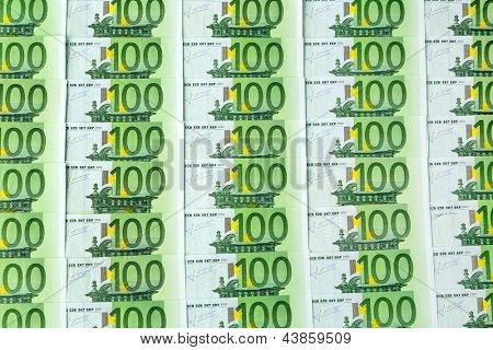 many einhhundert euro banknotes lie side by side. symbolic photo for wealth and investment