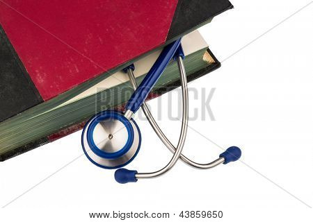 book and stethoscope, symbol photo for bungling, doctors mistake and expertise