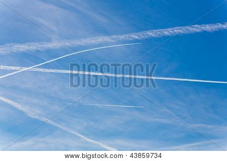 contrails of aircraft against a blue sky. routes in airways