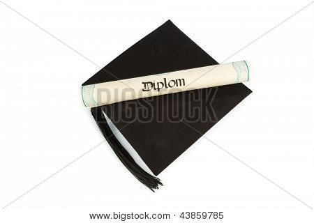 a diploma on a mortarboard, symbol photo for education and success