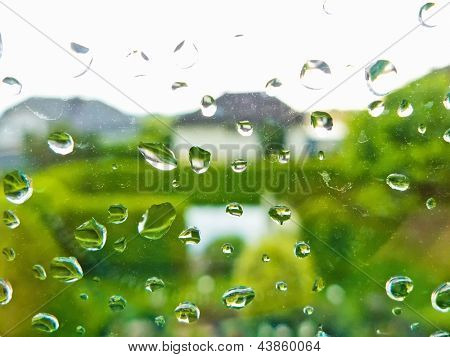 many raindrops in bad weather on a window pane. rainy weather