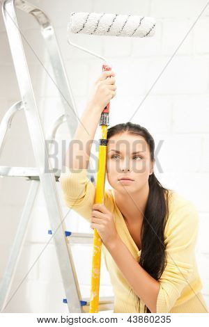 picture of bored and tired young woman with paintroller