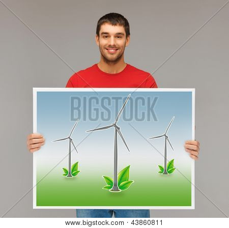 handsome man with picture of wind turbines
