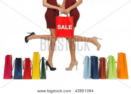 picture of woman's long legs with shopping bags.