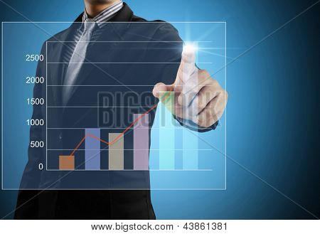 Business men hand pushing write graph