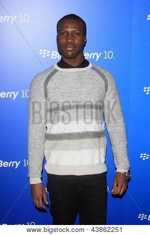 LOS ANGELES - MAR 20:  Amadou Ly arrives at the US launch of the Blackberry Z10 Smartphone at the Cecconi's on March 20, 2013 in West Hollywood, CA