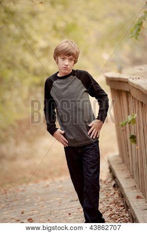 Depressed Teen Walking Alone On A Bridge