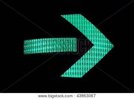 Green arrow of a traffic light