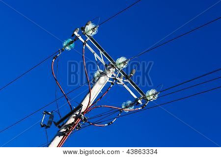 pole with electrical wires in the sky