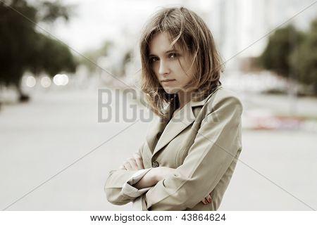 Sad young woman on a city street