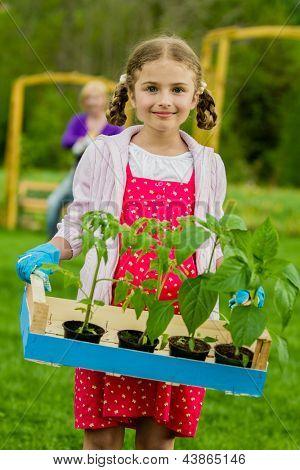 Gardening, garden, planting concept - lovely gardener working with mother in the garden