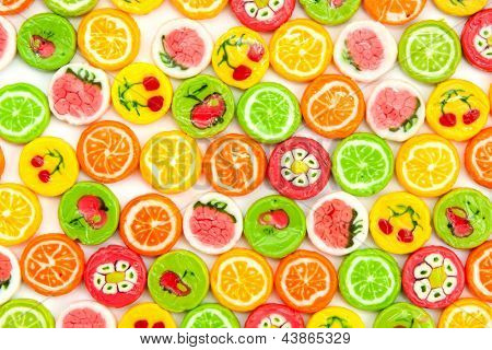many different tasty candies, background