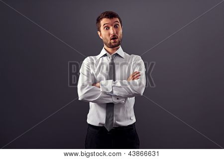portrait of surprised businessman over grey background