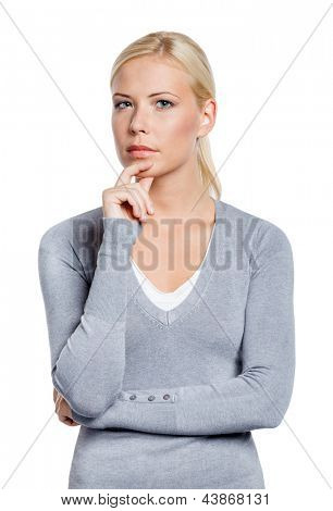 Half-length portrait of pensive girl touching her face, isolated on white