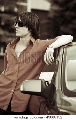 Young man with a convertible car