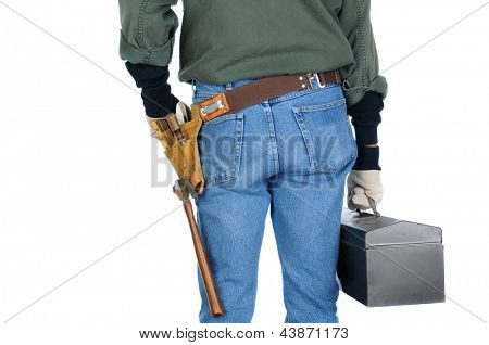 Closeup of a construction worker holding a tool box. Man is view from behind on a white background.
