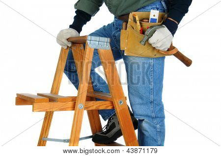 Closeup of a construction worker climbing a ladder with a hammer in his hand. horizontal format on a white background. Man is unrecognizable.