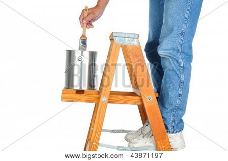 Closeup of a painter standing on a ladder dipping his brush into the paint can.. Man is unrecognizable on a white background.