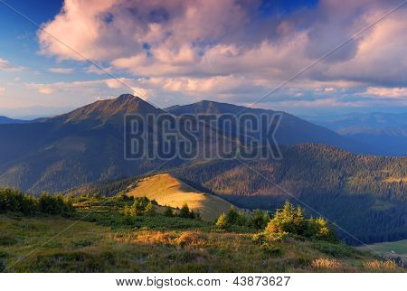 Landscape with sunset over the mountain ridge