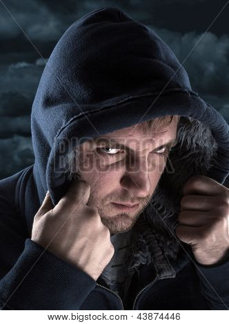 Serious bandit hiding under a hood