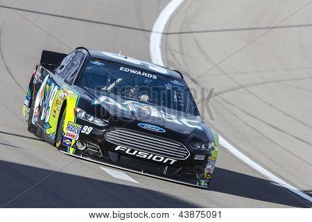 LAS VEGAS, NV - MAR 07, 2013:  Carl Edwards (99) brings his Aflac Ford Fusion through the turns during the Kobalt Tools 400 at Las Vegas Motor Speedway in Las Vegas, NV on March 07, 2013.