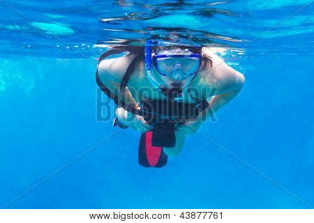 Young women snorkeling in the Andaman sea with underwater camera