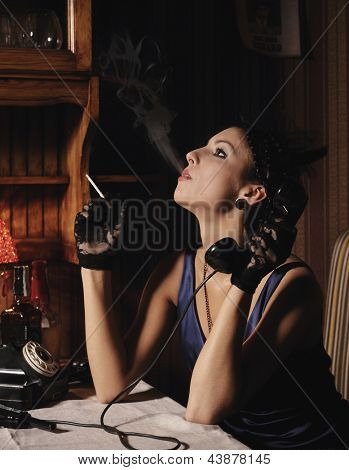 Woman portrait  in retro style, smoking and talking by phone.