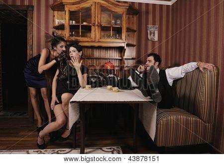 Mistresses discuss their benefactor, retro style.