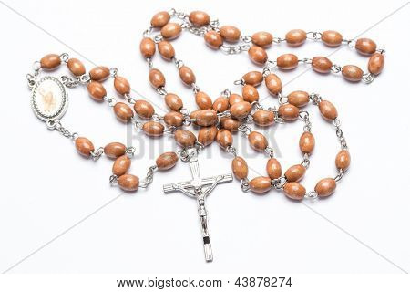 Rosary beads on white background