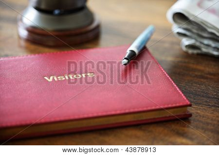 Hotel guest book or comments book and service bell at reception