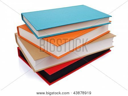 Stack of multi colored books isolated on white