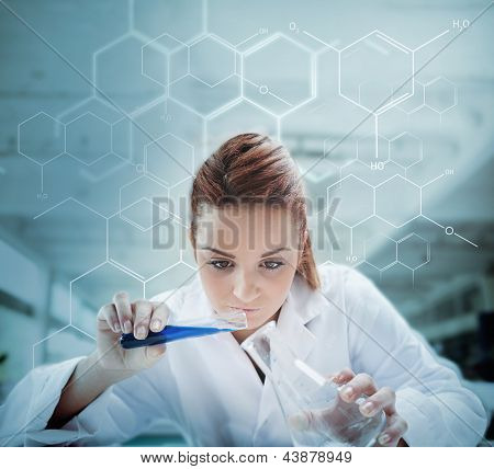 Scientist pouring liquid into erlenmeyer with futuristic screen showing formula behind her