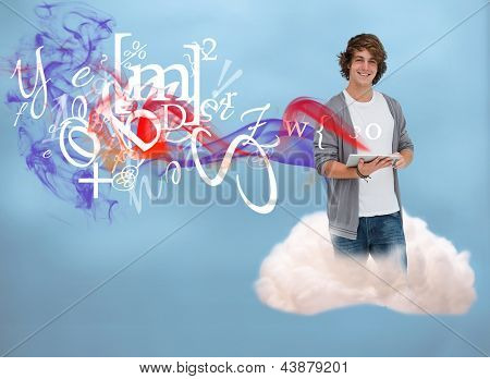 Casual young man using tablet to connect to cloud computing on blue background