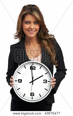 Business woman holding clock. Isolated over white