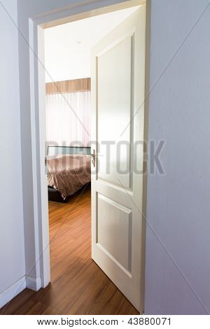 Door opening on a peaceful bedroom