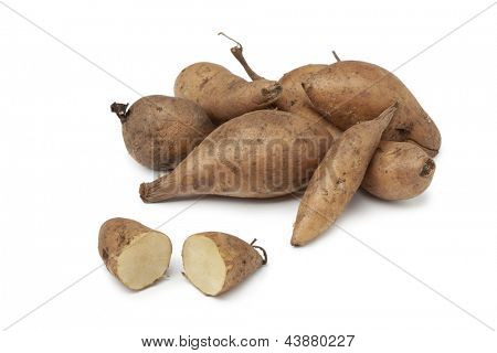 Fresh Yacon roots on white background