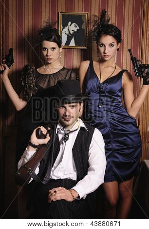 Portrait of three gangsters with guns, retro style.
