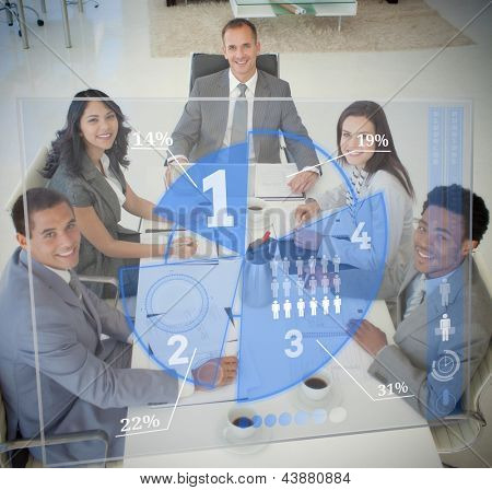 Business people using blue pie chart interface at board meeting