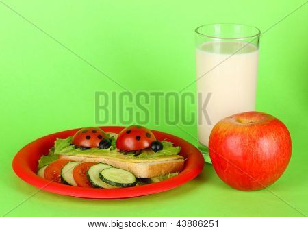 Fun food for kids on green background