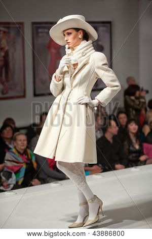MOSCOW - NOV 4: Models show dresses on charitable show My dream and way to it, in Fashion house of Slava Zaytsev, on Nov 4, 2011 in Moscow, Russia