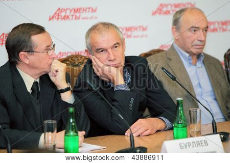 MOSCOW - DEC 2: Popular actors give interview about film Master and Margarita sitting at table in press private residence Arguments and Facts on December 2, 2010 in Moscow, Russia.